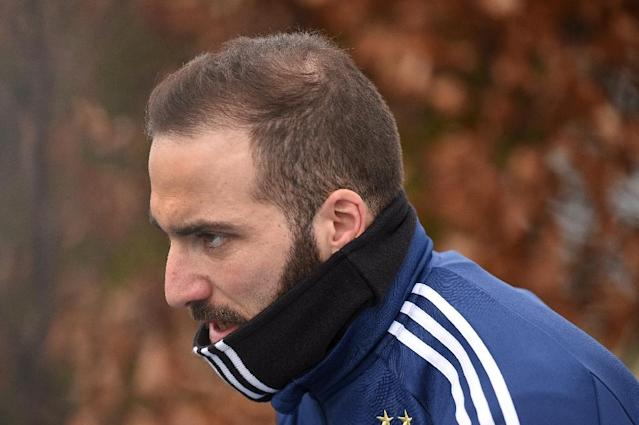 I almost quit: Argentina forward Gonzalo Higuain trains in Manchester on Wednesday ahead of Friday's friendly against Italy (AFP Photo/Oli SCARFF )