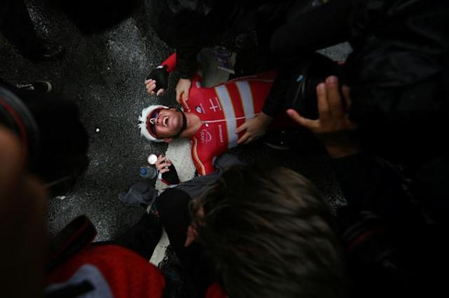 Exhausted and exultant Mads Pedersen of Denmark after winning cycling's road race world title (AFP Photo/BEN STANSALL)