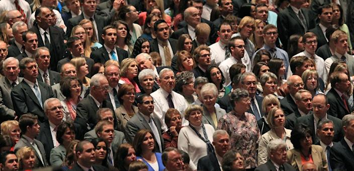 People look on during opening session of the two-day Mormon church conference Saturday, April 5, 2014, in Salt Lake City. More than 100,000 Latter-day Saints are expected in Salt Lake City this weekend for the church's biannual general conference. Leaders of The Church of Jesus Christ of Latter-day Saints give carefully crafted speeches aimed at providing members with guidance and inspiration in five sessions that span Saturday and Sunday. They also make announcements about church statistics, new temples or initiatives. In addition to those filling up the 21,000-seat conference center during the sessions, thousands more listen or watch around the world in 95 languages on television, radio, satellite and Internet broadcasts. (AP Photo/Rick Bowmer)