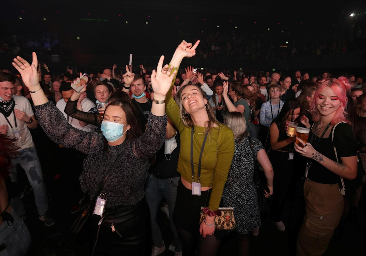 People attend a music event at Ziggo Dome venue, which opened its doors to small groups of people that have been tested negative of the coronavirus disease (COVID-19) in Amsterdam, Netherlands March 6, 2021. Picture taken March 6, 2021. REUTERS/Eva Plevier