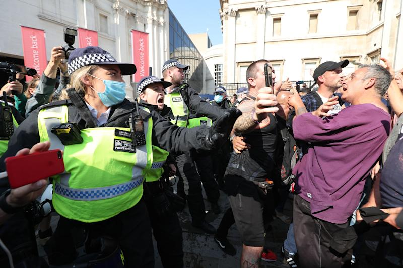 Police talk to demonstrators during an anti-vax protest in London's Trafalgar Square. (Photo: PA)
