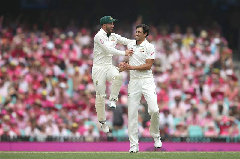 Mitchell Starc celebrates with Matthew Wade of Australia after dismissing BJ Watling of New Zealand during day three of the Third Test match in the series between Australia and New Zealand at Sydney Cricket Ground on January 05, 2020 in Sydney, Australia.