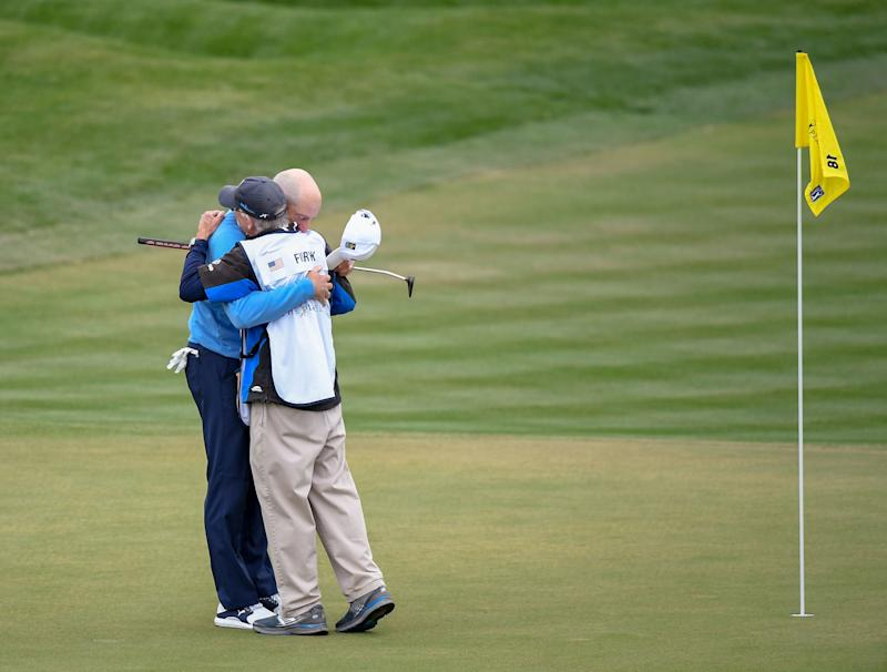 Furyk is congratulated by his caddie, Mike (Fluff) Cowan, after making birdie on TPC Sawgrass' 18th hole to close out the tournament.