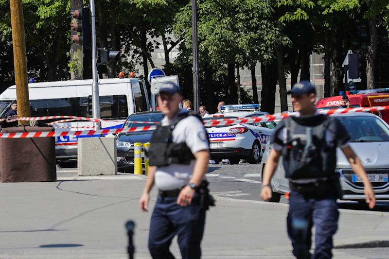 Police seal off an area of the Champs-Elysees in Paris on June 19, 2017
