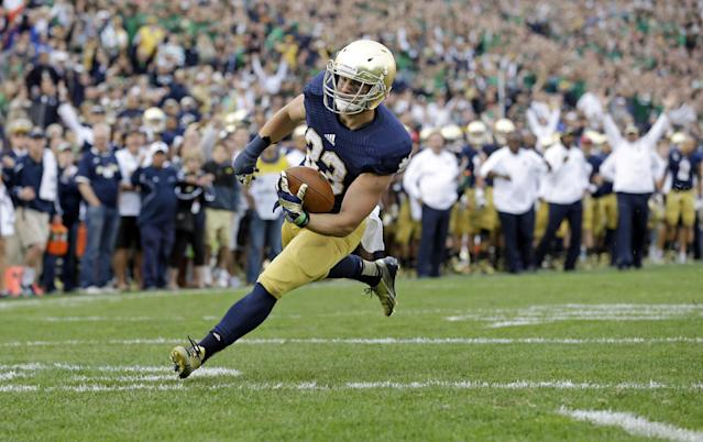 FILE - In this Sept. 21, 2013, file photo, Notre Dame running back Cam McDaniel scores a touchdown against Michigan State during the second half of an NCAA college football game in South Bend, Ind. The 5-10, 207-pound junior from Coppell, Texas, has started only one game this year, yet he is the running back Notre Dame coaches turn to when they are trying to ice a victory (AP Photo/Michael Conroy, File)