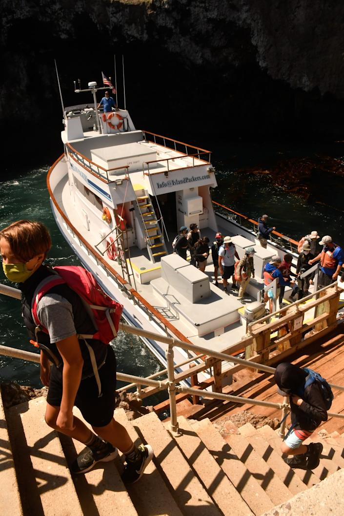 """On an Island Packers trip from Oxnard to Anacapa Island, passengers climb the more than 150 steps that lead to the flat top of the island. <span class=""""copyright"""">(Christopher Reynolds / Los Angeles Times)</span>"""