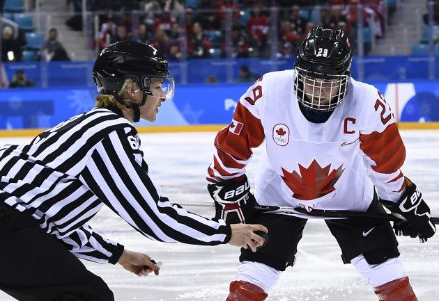 Canada's Marie-Philip Poulin waits for the puck to drop in the women's gold medal hockey game.