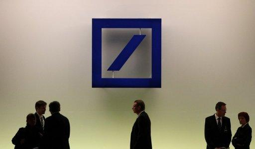 Debt crisis cuts Deutsche Bank profits in half