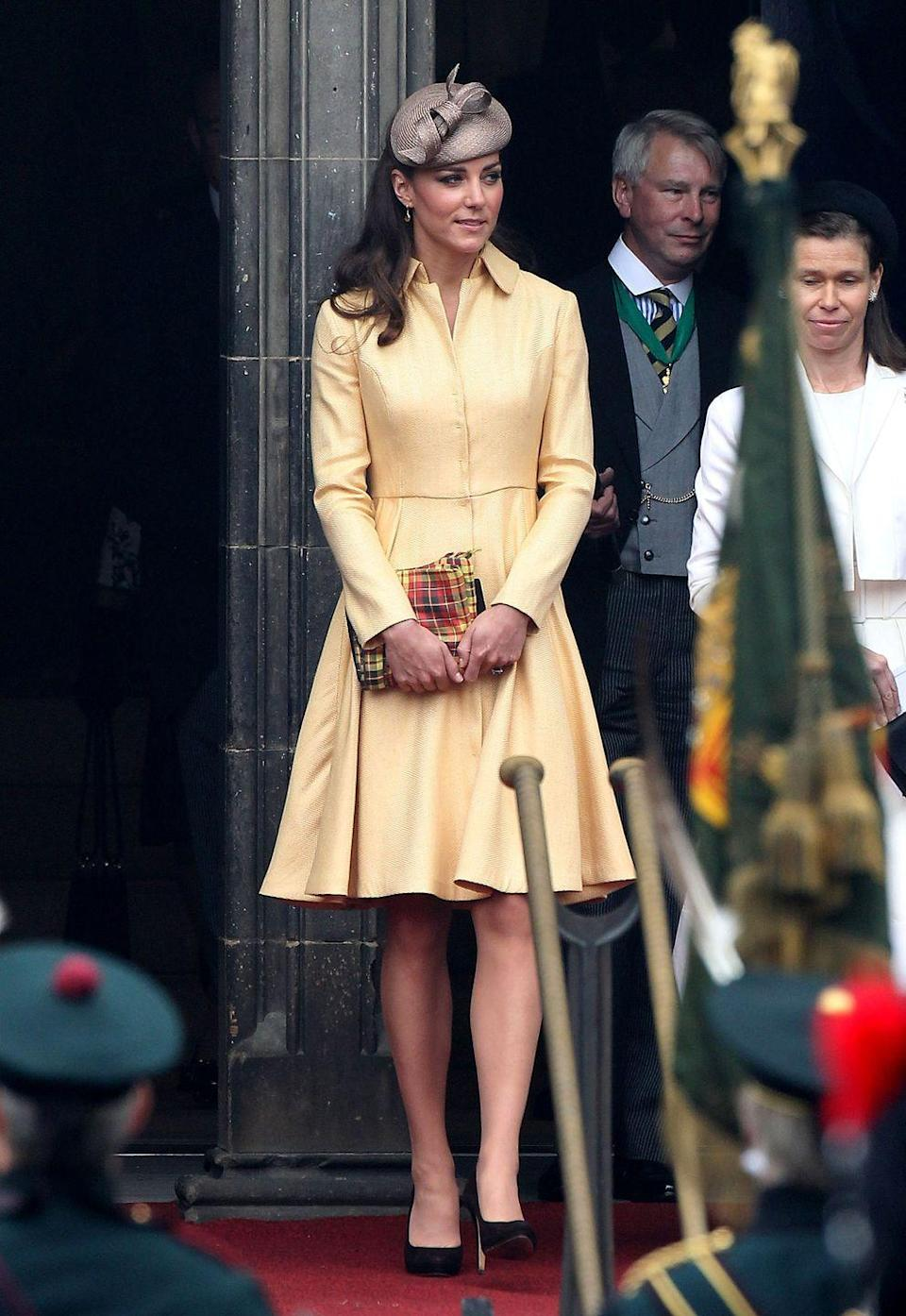 <p>To attend the Thistle Ceremony in Edinburgh, Kate wore a bespoke Emilia Wickstead coat dress in yellow. William became a part of the Order of the Thistle that day. </p>