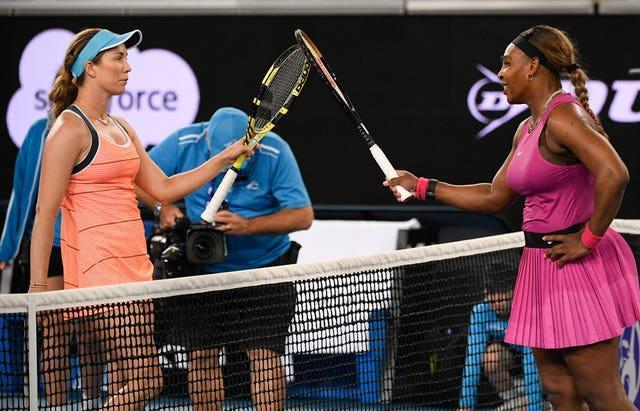 Serena Williams, right, touches rackets with Danielle Collins