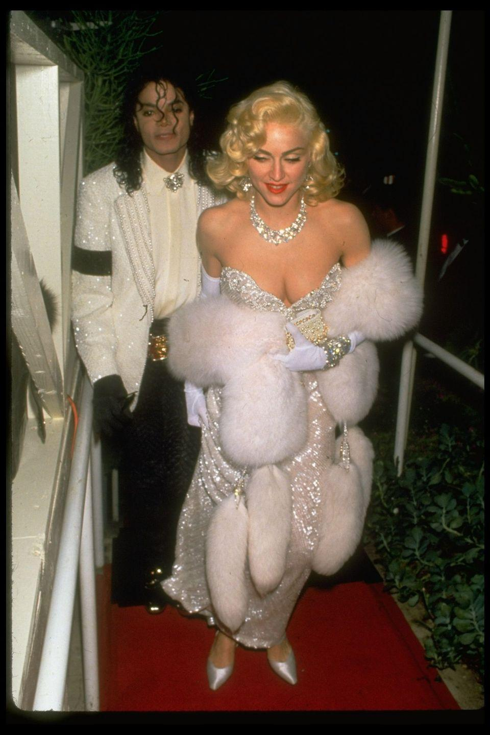 <p>Sparkling in Harry Winston jewels and a bedazzled gown, with Michael Jackson, at the 1991 Academy Awards.</p>