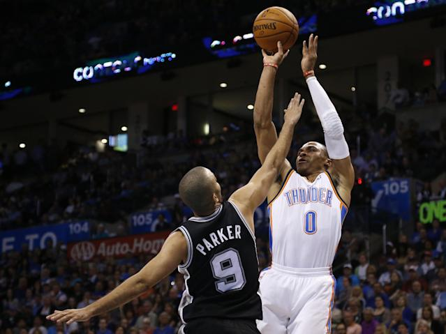 Oklahoma City Thunder guard Russell Westbrook (0) shoots over San Antonio Spurs guard Tony Parker (9) during the first quarter of an NBA basketball game in Oklahoma City, Thursday, April 3, 2014. (AP Photo/Sue Ogrocki)