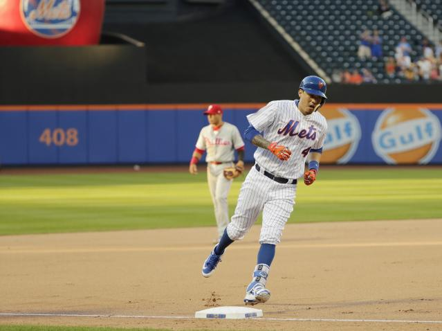 New York Mets' Wilmer Flores (4) runs the bases after hitting a walk-off home run during the tenth inning in the first game of a baseball doubleheader against the Philadelphia Phillies Monday, July 9, 2018, in New York. The Mets won 4-3. (AP Photo/Frank Franklin II)