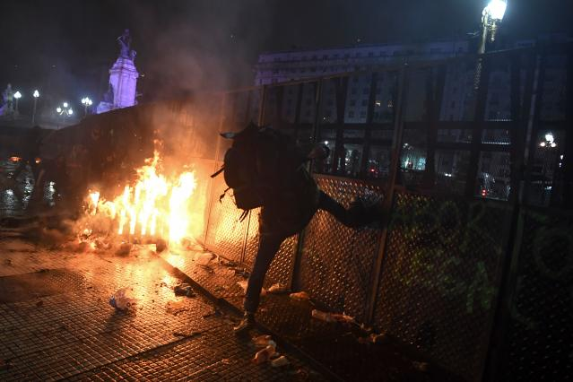 <p>A man kicks a fence during protests outside the National Congress in Buenos Aires on Aug. 9, 2018, after senators rejected the bill to legalize abortion. (Photo: Eitan Abramovich/AFP/Getty Images) </p>