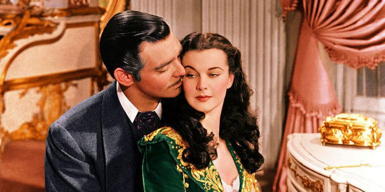 <p>For as much of a whirlwind that <em>Gone with the Wind </em><span>truly is, its production might have been even more intense. From the never-ending search for Scarlett, the ever-changing</span> management and disgruntled actors, it seems short of a miracle that the film actually <em>happened</em><span>. And that famous kiss scene? Not so passionate (one word: dentures). Confounding script and scandal aside, there's just nothing better than <em>Gone with the Wind </em><span>- that's just a fact.</span></span></p>