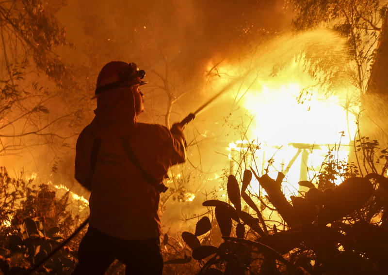 Trump blames 'gross mismanagement' for Calif. wildfires, threatens to withhold federal money