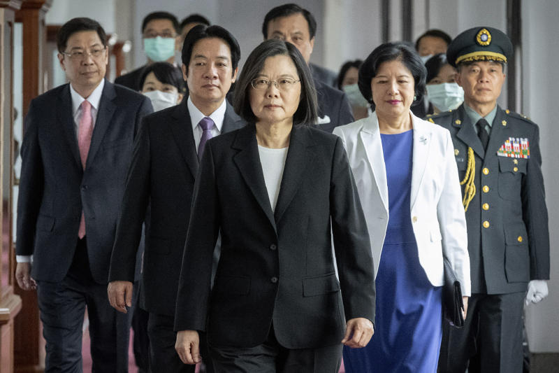 In this photo released by the Taiwan Presidential Office, Taiwanese President Tsai Ing-wen, center, walks ahead of Vice-President Lai Ching-te, left of her, as they attend an inauguration ceremony in Taipei, Taiwan, Wednesday, May 20, 2020. Tsai was inaugurated for a second term amid increasing pressure from China on the self-governing island democracy it claims as its own territory. (Taiwan Presidential Office via AP)