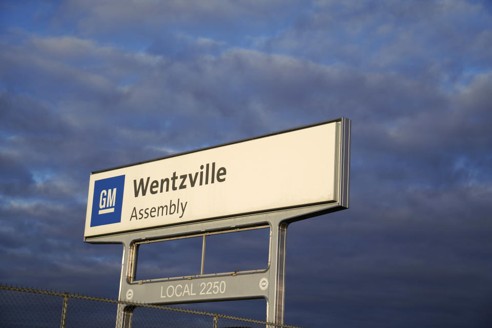 This March 24, 2021 photo shows a sign near an entrance to a General Motors assembly plant in Wentzville, Mo. Unionized auto workers in the U.S. will go back to wearing masks in all factories, offices and warehouses starting Wednesday, Aug. 4, because of the spreading delta coronavirus variant.(AP Photo/Jeff Roberson)