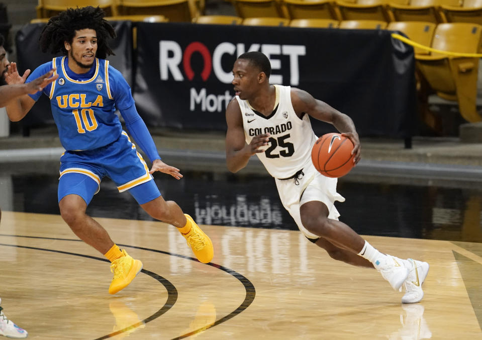 Colorado guard McKinley Wright IV, right, drives past UCLA guard Tyger Campbell in the first half of an NCAA college basketball game Saturday, Feb. 27, 2021, in Boulder, Colo. (AP Photo/David Zalubowski)