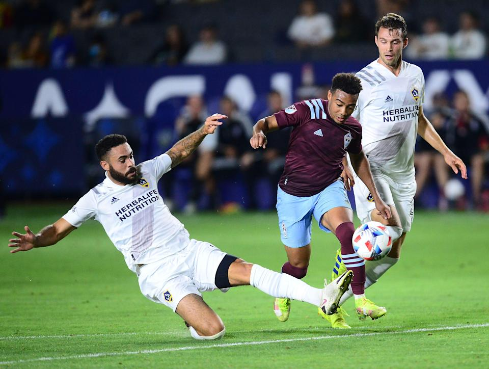 Los Angeles Galaxy defender Derrick Williams (left) moves in for the ball against the Colorado Rapids' Jonathan Lewis during the Rapids' 2-1 win on Aug. 17 at Dignity Health Sports Park.