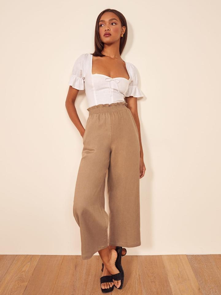 """<p>The shade of these <a href=""""https://www.popsugar.com/buy/Reformation%20Calabria%20Pants-471297?p_name=Reformation%20Calabria%20Pants&retailer=thereformation.com&price=158&evar1=fab%3Auk&evar9=46411415&evar98=https%3A%2F%2Fwww.popsugar.com%2Ffashion%2Fphoto-gallery%2F46411415%2Fimage%2F46411526%2FReformation-Calabria-Pants&list1=shopping%2Cpants%2Csummer%2Csummer%20fashion&prop13=api&pdata=1"""" rel=""""nofollow"""" data-shoppable-link=""""1"""" target=""""_blank"""" class=""""ga-track"""" data-ga-category=""""Related"""" data-ga-label=""""https://www.thereformation.com/products/calabria-pant?color=Khaki"""" data-ga-action=""""In-Line Links"""">Reformation Calabria Pants</a> ($158) is so chic.</p>"""