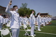 Cadets stand during the commencement for the United States Coast Guard Academy in New London, Conn., Wednesday, May 19, 2021. (AP Photo/Andrew Harnik)