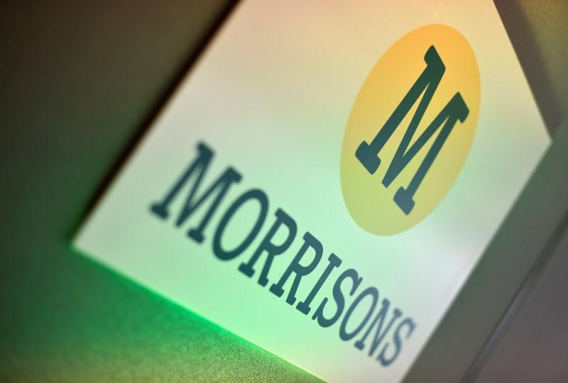 Branding for Morrisons is seen in a conference room in central London
