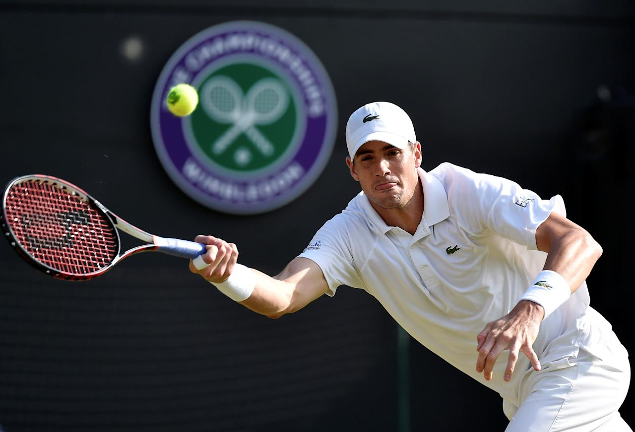 FILE PHOTO: John Isner of the U.S.A. hits a shot during his match against Marin Cilic of Croatia at the Wimbledon Tennis Championships in London, July 3, 2015.      REUTERS/Toby Melville/File Photo