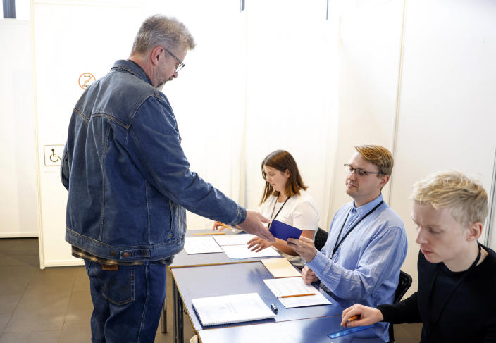 Gunnar Smari Egilsson, candidate for the Socialist Party, casts his vote in Reykjavik, Iceland, Saturday, Sept. 25, 2021. Icelanders are voting in a general election dominated by climate change, with an unprecedented number of political parties likely to win parliamentary seats. (AP Photo/Brynjar Gunnarsson)