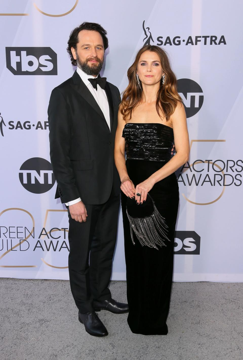 <p><em>The Americans</em> stars and real-life couple Matthew Rhys and Keri Russell attend the 2019 Screen Actors Guild Awards. (Photo: Getty Images) </p>