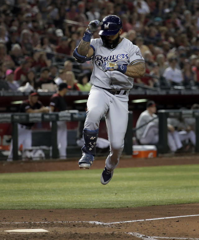 Milwaukee Brewers' Eric Thames crosses home plate after hitting a solo home run against the Arizona Diamondbacks during the sixth inning of a baseball game, Saturday, July 20, 2019, in Phoenix. (AP Photo/Matt York)