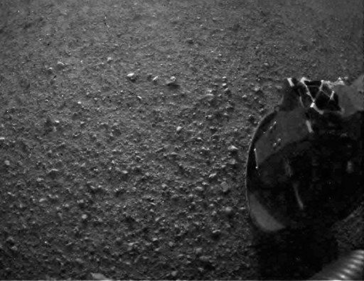 This is one of first images taken by NASA's Curiosity taken from a rear camera on the $2.5 billion rover. NASA has successfully landed its one-ton rover on the surface of the red planet, breaking new ground in US-led exploration of an alien world