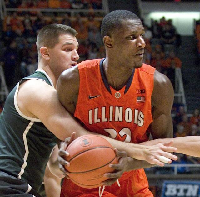 Illinois' Nnanna Egwu (32) is wrapped up by Michigan State's forward Alex Gauna (2) during an NCAA college basketball game in Champaign, Ill., on Saturday, Jan. 18, 2014. (AP Photo/Robin Scholz)
