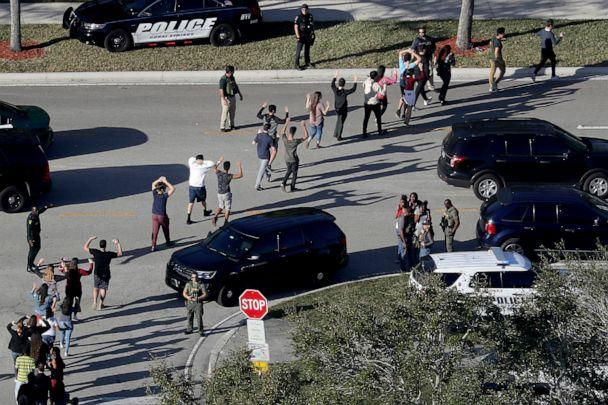 PHOTO: Students hold their hands in the air as they are evacuated by police from Marjory Stoneman Douglas High School in Parkland, Fla., Feb. 14, 2018, after a shooter opened fire on the campus. (Mike Stocker/South Florida Sun-Sentinel via AP)