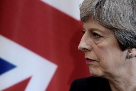 Britain's Prime Minister Theresa May listens to the French President during a bilateral meeting at the G7 Summit in Taormina