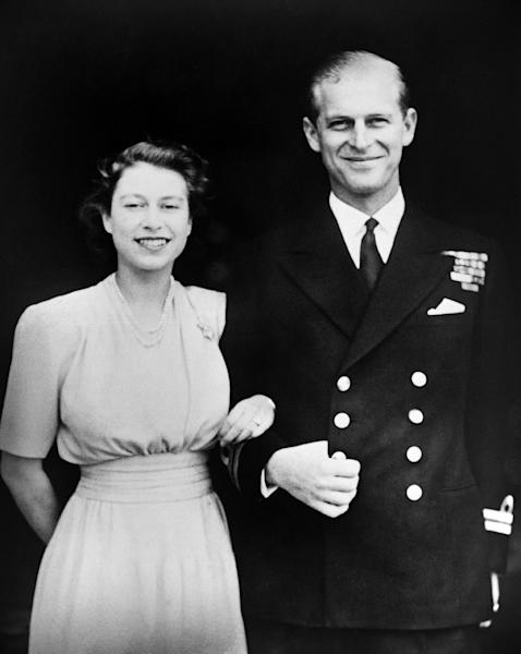 Photo taken on July 11, 1947, shows Princess Elizabeth (future Queen Elizabeth II) and Philip of Greece (future Duke of Edinburgh) posing on the day of their engagement in July 1947. (AFP Photo/STR)