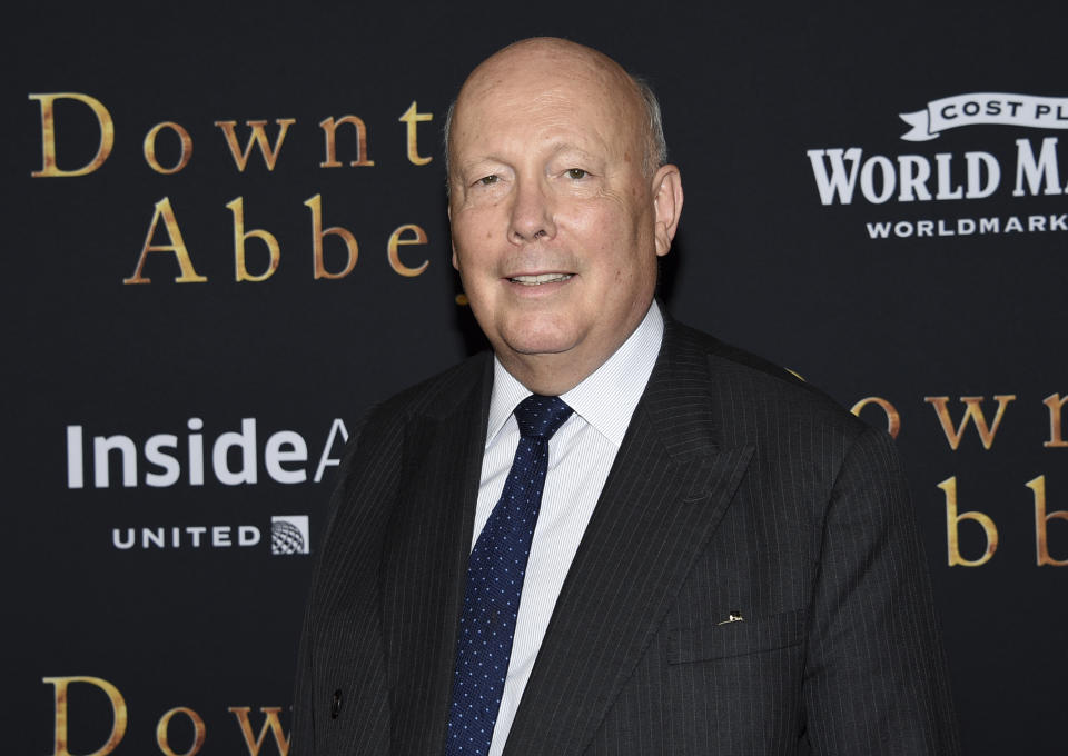 """FILE - In this Sept. 16, 2019, file photo writer-producer Julian Fellowes attends the premiere of """"Downton Abbey,"""" at Alice Tully Hall in New York. """"Belgravia,"""" set in the grand London neighborhood of that name, was adapted by Fellowes from his eponymous 2016 novel. Asked to compare the series to """"Downton Abbey,"""" the hit TV drama that unfolded in the early 1900s, Fellowes said the projects reflect the periods in which they're set. (Photo by Evan Agostini/Invision/AP)"""