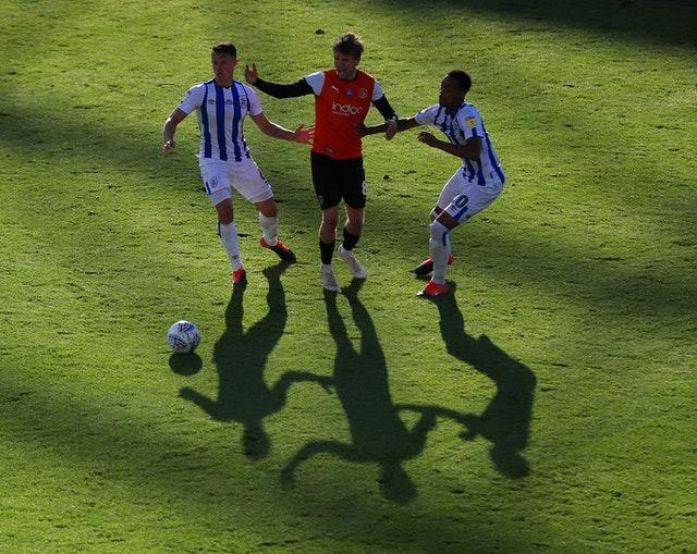 Huddersfield players Jonathan Hogg and Chris Willock battling for the ball
