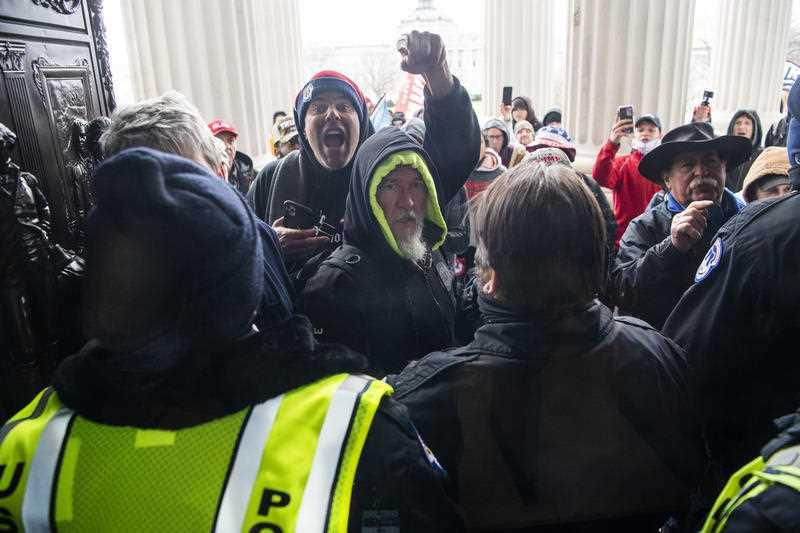 Rioters attempt to enter the US Capitol at the House steps during a joint session of Congress to certify the Electoral College vote.