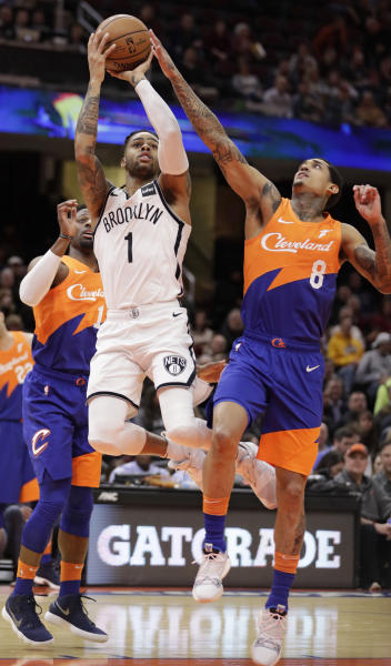 Brooklyn Nets' D'Angelo Russell (1) drives to the basket against Cleveland Cavaliers' Jordan Clarkson (8) in the first half of an NBA basketball game, Wednesday, Feb. 13, 2019, in Cleveland. (AP Photo/Tony Dejak)