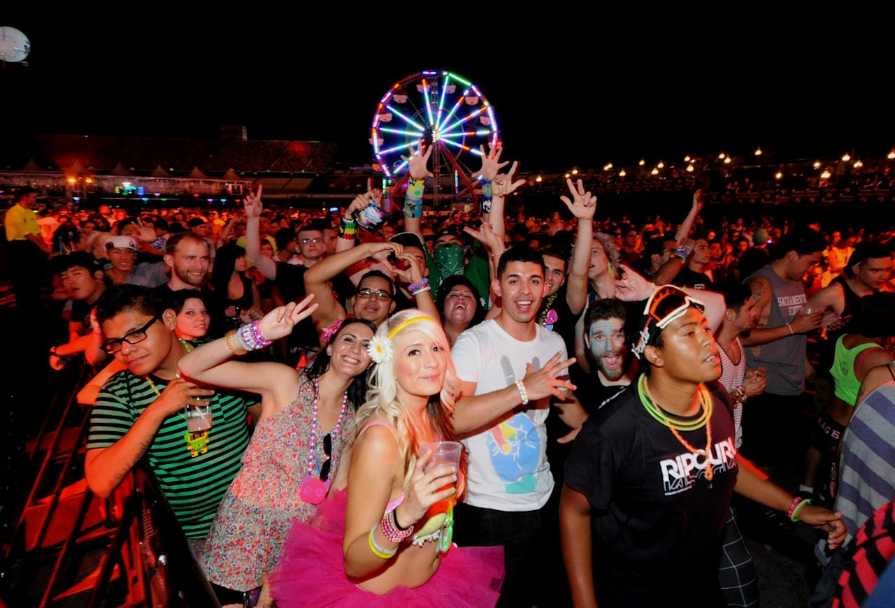 In this photo provided by the Las Vegas News Bureau, people attend the Electric Daisy Carnival, Saturday, June 25, 2011, in Las Vegas. The Electric Daisy Carnival kicked off Friday for a weekend of outdoor music and dancing in Las Vegas with 26 carnival rides, kaleidoscope sculptures, pyrotechnic displays, a pulsating soundtrack and a reputation for heavy drug use that it hoped to live down. (AP Photo/Las Vegas News Bureau, Glenn Pinkerton)