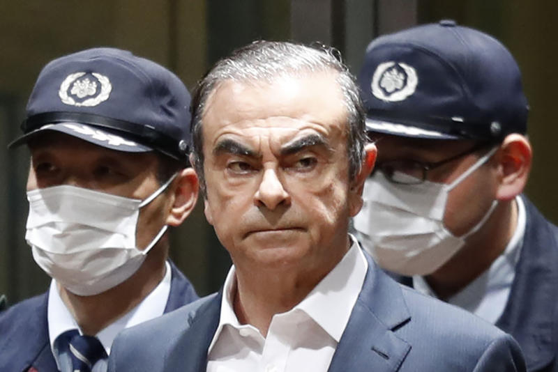 FILE - In this April  25, 2019, file photo, former Nissan Chairman Carlos Ghosn leaves Tokyo's Detention Center for bail in Tokyo. By jumping bail, Ghosn, who had long insisted on his innocence, has now committed a clear crime and can never return to Japan without going to jail. (Kyodo News via AP, File)