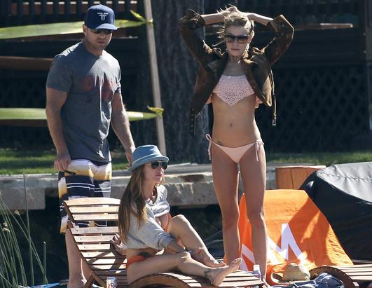 When you have multiple bathing suits, it's hard to choose just one. LeAnn Rimes relaxed on the dock of a cabin with her husband Eddie Cibrian and friends in Los Angeles, Calif., on July 15th, 2012. The singer also sported a turquoise bikini the same day