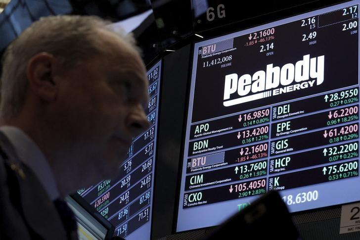 Traders work at the post where Peabody Energy is traded on the floor of the NYSE