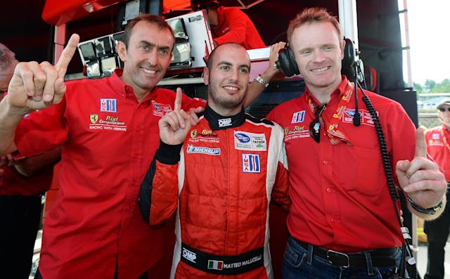 From left, Olivier Beretta, of Monaco, Matteo Malucelli, of Italy, and Robin Liddell, of Scotland, celebrate their GT class pole position after qualifying for the American Le Mans Series' Petit Le Mans auto race at Road Atlanta, Friday, Oct. 18, 2013, in Braselton, Ga. (AP Photo/Rainier Ehrhardt)