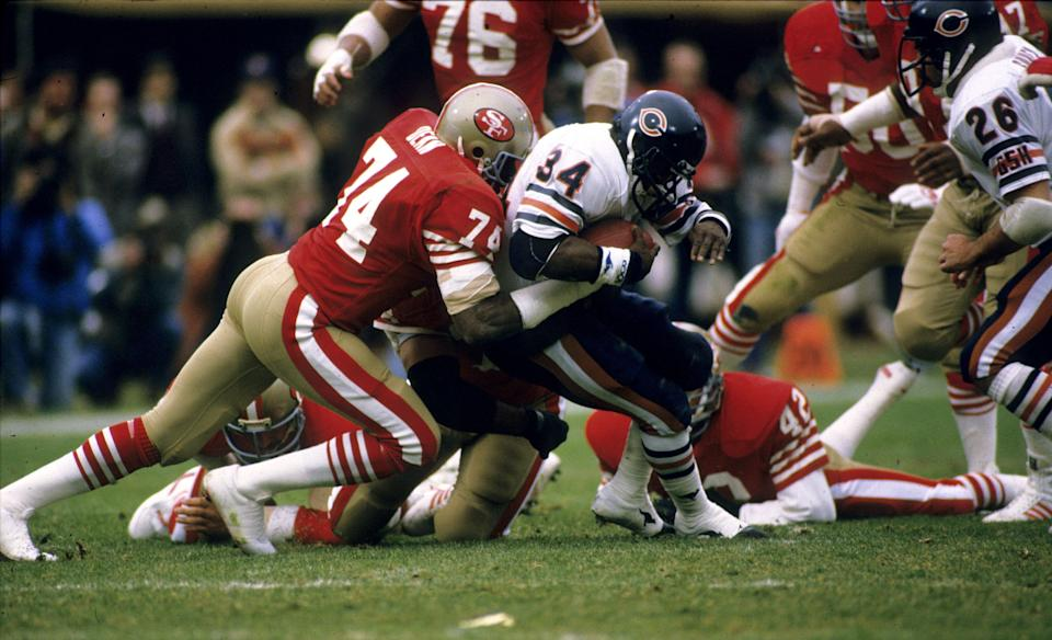 Fred Dean tackles future fellow Hall of Famer Walter Payton in the 1984 NFC Championship Game. (Photo: Rob Brown via Getty Images)