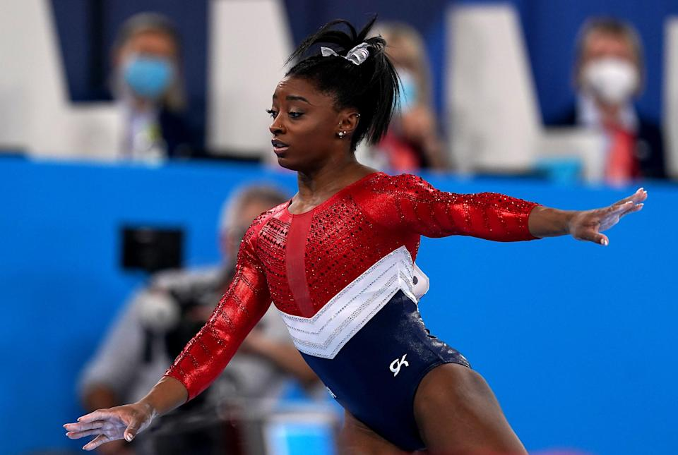 Simone Biles is mulling over whether to continue in Tokyo (Martin Rickett/PA) (PA Wire)