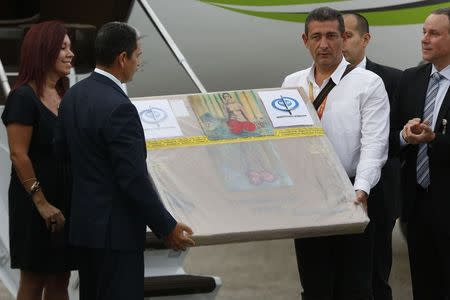 "A box containing a painting of French master Henri Matisse, known as ""Odalisque in Red Pants"" (Odalisque a la Culotte Rouge), arrives at Maiquetia International Airport in Caracas"