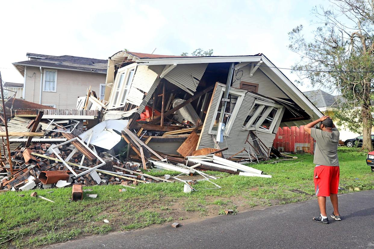 Dartanian Stovall looks at the house that collapsed with him inside during the height of Hurricane Ida in New Orleans on Aug. 30.
