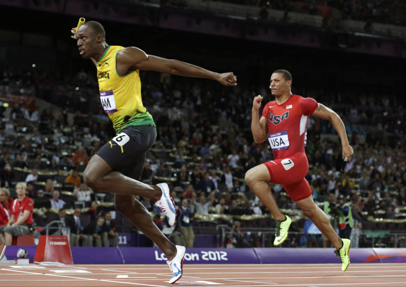 Jamaica's Usain Bolt, left, crosses the finish line ahead of Ryan Bailey of the United States in the men's 4x100-meter relay final during the athletics in the Olympic Stadium at the 2012 Summer Olympics, London, Saturday, Aug. 11, 2012. Jamaica set a new world record with a time of 36.84 seconds. (AP Photo/David J. Phillip)